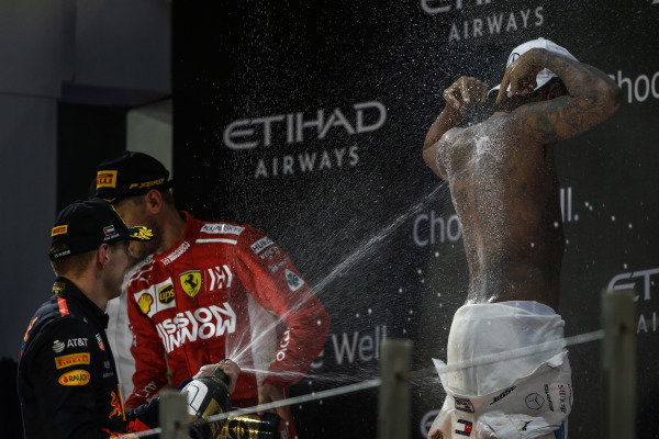 Max Verstappen, Red Bull Racing, 3rd position, sprays Lewis Hamilton, Mercedes AMG F1, 1st position, with Rose Water after he strips to the waist on the podium