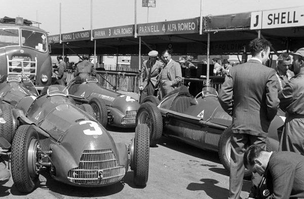 The Alfa Romeo 158s of Luigi Fagioli (#3), Giuseppe Farina (#2), and Reg Parnell (#4) in the pits.