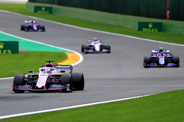 Sergio Perez, Racing Point RP19, leads Pierre Gasly, Toro Rosso STR14, and Lance Stroll, Racing Point RP19
