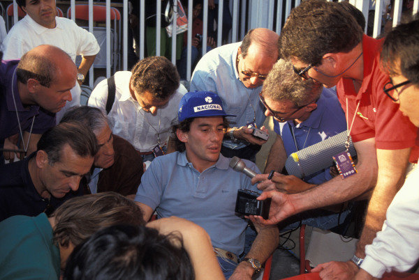 Ayrton Senna talks to the media.
