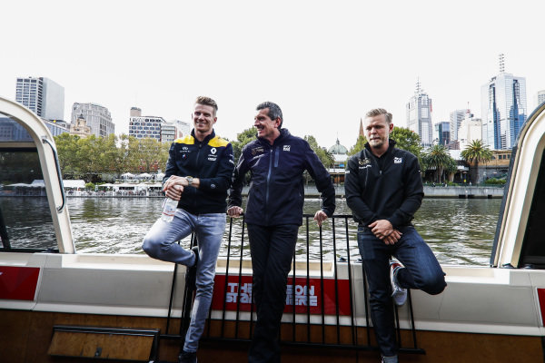 Nico Hulkenberg, Renault F1 Team, Guenther Steiner, Team Principal, Haas F1 and Kevin Magnussen, Haas F1 Team on the way to the Federation Square event.