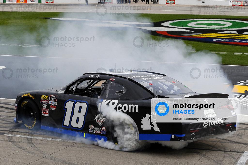 #18: Kyle Busch, Joe Gibbs Racing, Toyota Supra iK9 celebrates his win with a burnout