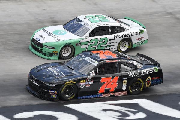 #22: Austin Cindric, Team Penske, Ford Mustang MoneyLion, #74: Mike Harmon, Mike Harmon Racing, Chevrolet Camaro Woobies Shoes