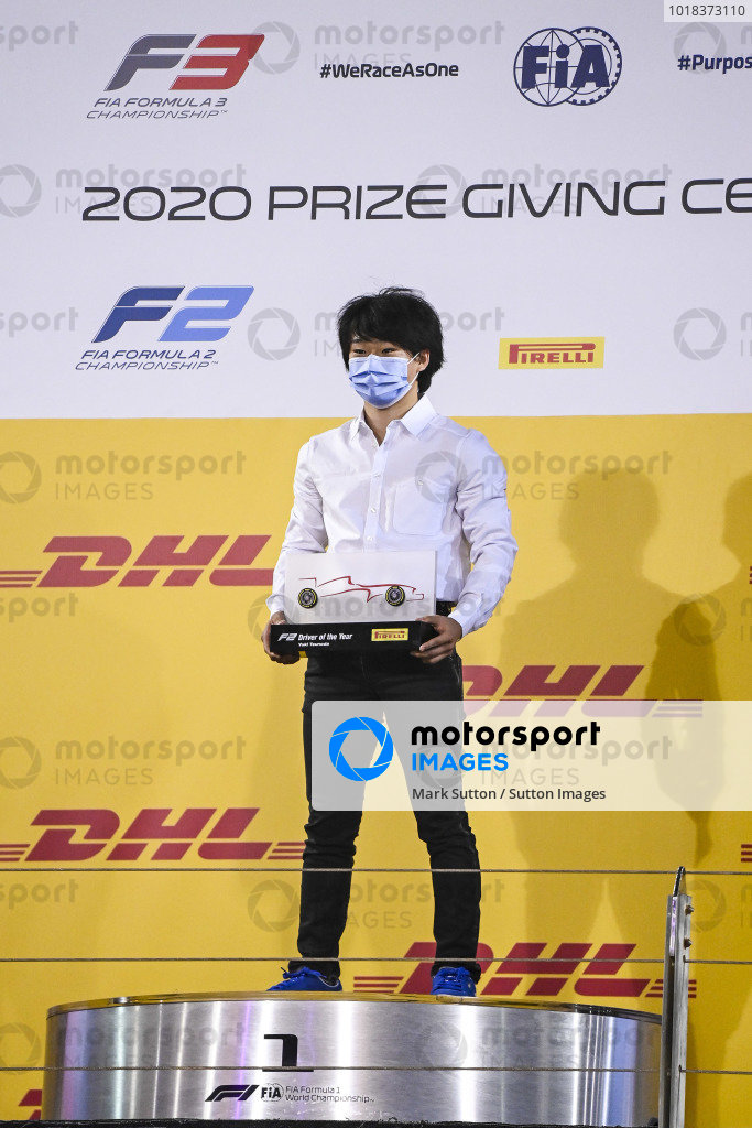 F2 driver of the year Yuki Tsunoda (JPN, CARLIN) celebrates on the podium with the trophy