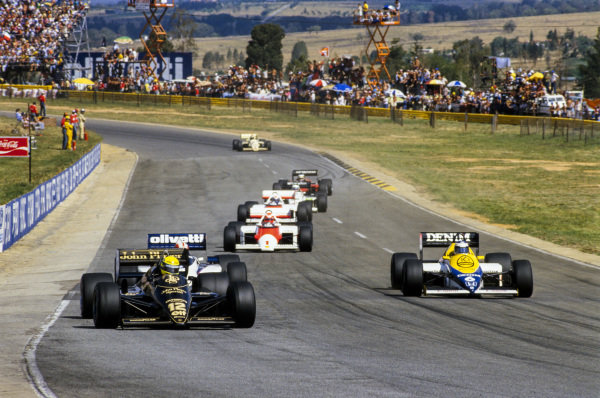 Ayrton Senna, Lotus 97T Renault, leads Marc Surer, Brabham BT54 BMW, Keke Rosberg, Williams FW10 Honda, Niki Lauda, McLaren MP4-2B TAG, and Alain Prost, McLaren MP4-2B TAG.