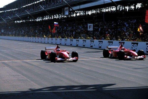 Michael Schumacher (GER) Ferrari F2002 and team mate Rubens Barrichello (BRA) Ferrari F2002 cross the line just 0.010 seconds apart for the closest finish in F1 history. Formula One World Championship, Rd16, United States Grand Prix, Indianapolis, USA, 29 September 2002. BEST IMAGE