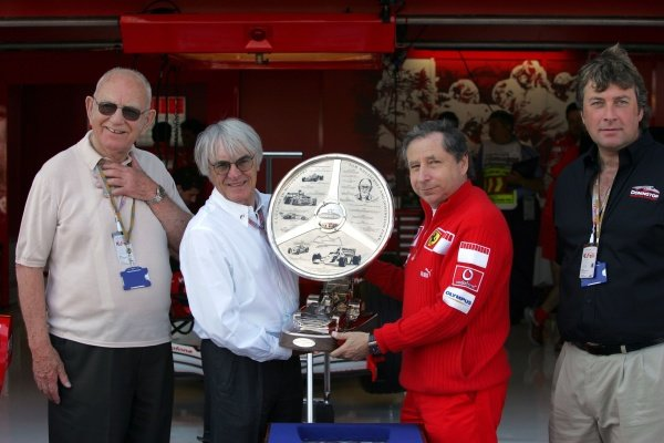 Tom Wheatcroft (GBR) Donington Park owner, Bernie Ecclestone (GBR) F1 Supremo, Jean Todt (FRA) Ferrari General Manager and Kevin Wheatcroft (GBR) of Donington Park at the presentation of The Tom Wheatcroft Trophy. Formula One World Championship, Rd11, British Grand Prix, Race Day, Silverstone, England, 10 July 2005. DIGITAL IMAGE
