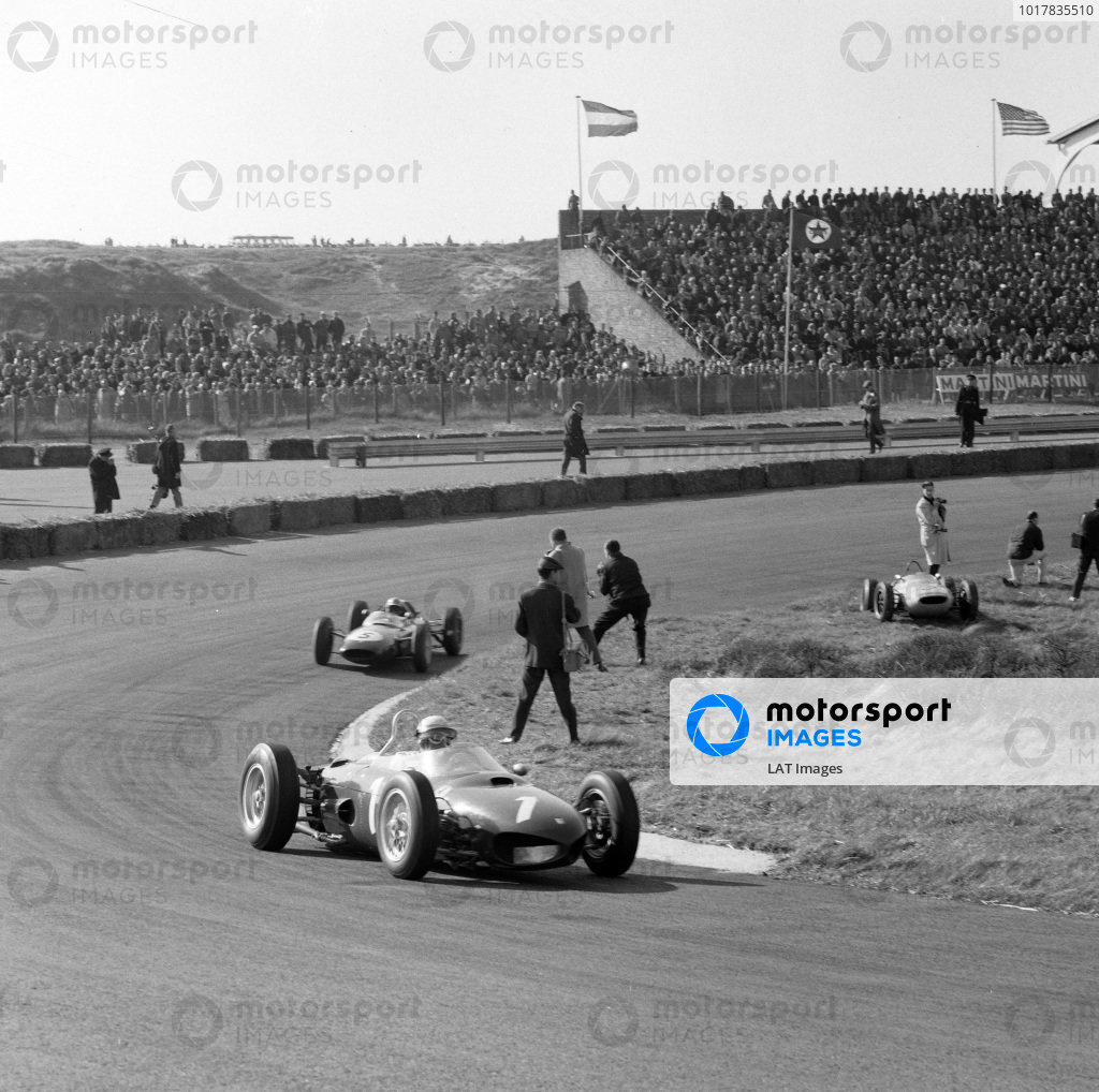 Phil Hill, Ferrari 156, leads Trevor Taylor, Lotus 24 Climax.