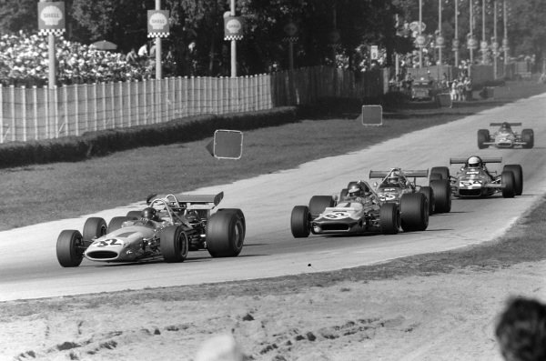 Peter Gethin, McLaren M14A Ford leads Ronnie Peterson, March 701 Ford and Chris Amon, March 701 Ford.