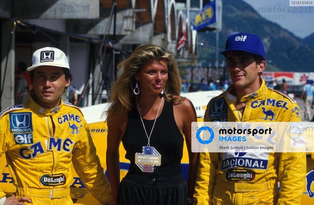 Satoru Nakajima (JPN) Lotus 99t (L), Ayrton Senna (BRA) Lotus 99t (R) and a lady. Brazilian Grand Prix, Rio de Janeiro, 12 April 1987