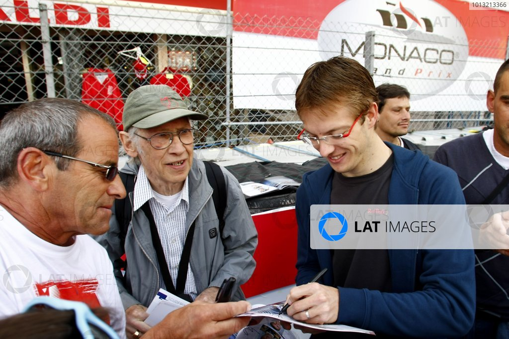 2008 Monaco Grand Prix - Wednesday Monte Carlo, Monaco. 21st May 2008. Sebastien Bourdais, Toro Rosso STR03 Ferrari signs autographs for fans. Portrait. World Copyright: Charles Coates/LAT Photographic. ref: Digital Image _26Y4840