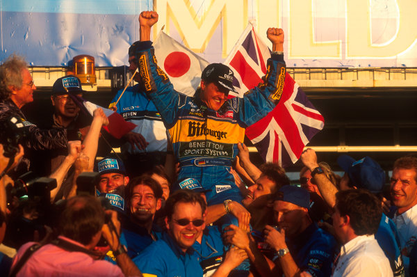 Tanaka International, Aida, Japan.20-22 October 1995.Michael Schumacher (Benetton Renault) 1st position, celebrates taking his second successive drivers world championship with the team.Ref-95 PAC 09.World Copyright - LAT Photographic