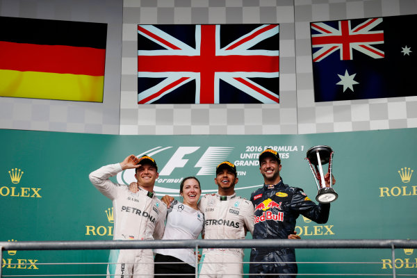 Circuit of the Americas, Austin Texas, USA. Sunday 23 October 2016. Nico Rosberg, Mercedes AMG, Victoria Vowles, Partner Services Director, Mercedes AMG, Lewis Hamilton, Mercedes AMG, 1st Position, and Daniel Ricciardo, Red Bull Racing, 3rd Position, on the podium. World Copyright: Sam Bloxham/LAT Photographic ref: Digital Image _SLA2649