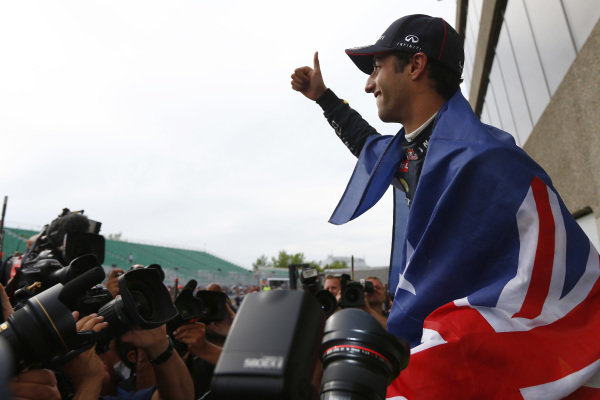 Circuit Gilles Villeneuve, Montreal, Canada. Sunday 8 June 2014. Daniel Ricciardo, Red Bull Racing, 1st Position, celebrates his maiden win with his team. World Copyright: Andy Hone/LAT Photographic. ref: Digital Image _ONZ3821