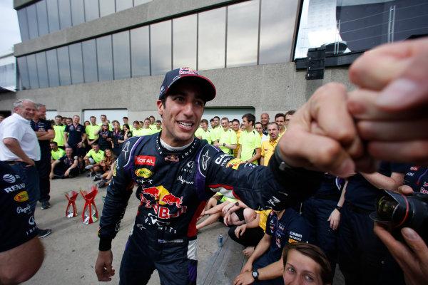 Circuit Gilles Villeneuve, Montreal, Canada. Sunday 8 June 2014. Daniel Ricciardo, Red Bull Racing, 1st Position, celebrates with his team. World Copyright: Steven Tee/LAT Photographic. ref: Digital Image _L4R9191