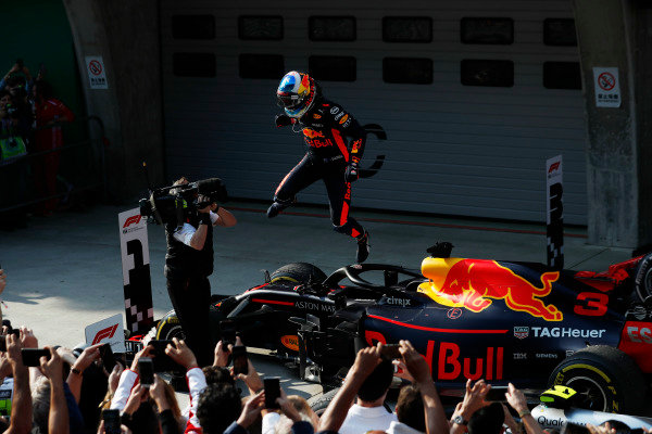Daniel Ricciardo, Red Bull Racing, celebrates victory by leaping off his car in parc ferme.