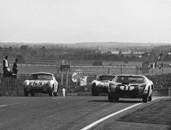 Le Mans, France. 20th - 21st June 1964.Richie Ginther/Masten Gregory (Ford GT40), retired, passes Bob Bondurant/Dan Gurney (AC Cobra Daytona ), 4th position and Clive Baker/Bill Bradley (Austin-Healey Sprite), 24th position, action. World Copyright: LAT Photographic.Ref:  B/WPRINT.