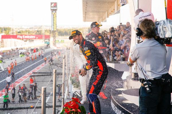 Suzuka Circuit, Japan. Sunday 8 October 2017. Daniel Ricciardo, Red Bull Racing, 3rd Position, sprays champagne on the podium. World Copyright: Joe Portlock/LAT Images  ref: Digital Image _L5R9855