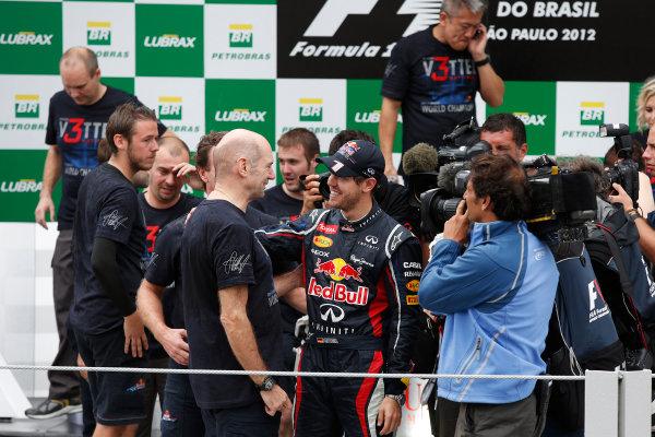 Interlagos, Sao Paulo, Brazil. Sunday 25th November 2012. 2012 World Champion Sebastian Vettel, Red Bull RB8 Renault, celebrates with the Red Bull team. World Copyright:Charles Coates/LAT Photographic ref: Digital Image _N7T8299