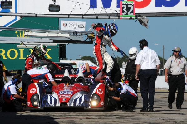 12-17 March 2012, Sebring, Florida, USAHenri Richard exits the Dempsey Racing Oreca FLM09.(c)2012, Paul WebbLAT Photo USA