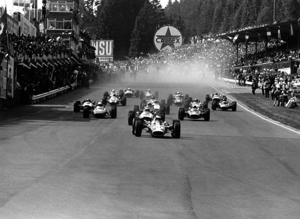 1967 Belgian Grand Prix Spa-Francorchamps, Belgium. 18 June 1967 Jim Clark, Lotus 49-Ford, 6th position, leads Jochen Rindt, Cooper T81B-Maserati, 4th position, Michael Parkes, Ferrari 312, retired, Chris Amon, Ferrari 312, 3rd position, Jackie Stewart, BRM P83, 2nd position, John Surtees, Honda RA273, retired, Jack Brabham, Brabham BT24-Repco, retired, and Mike Spence, BRM P83, 5th position, at the start. Eventual winner Dan Gurney, Eagle AAR104-Weslake, 1st position, is in the middle of the pack, action World Copyright: LAT PhotographicRef: 1593 #27A