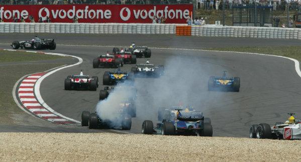 2003 European Grand Prix - Sunday Race, Nurburgring, Germany. 29th June 2003 Mark Webber, Jaguar R4, engine smokes at the start of the race.World Copyright: Steve Etherington/LAT Photographic ref: Digital Image Only