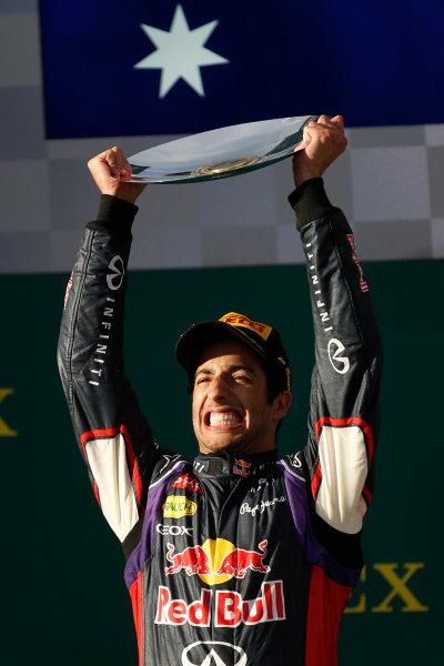 Albert Park, Melbourne, Australia. Sunday 16 March 2014. Daniel Ricciardo, Red Bull Racing, 2nd Position, lifts his trophy on the podium. World Copyright: Glenn Dunbar/LAT Photographic. ref: Digital Image _W2Q3552