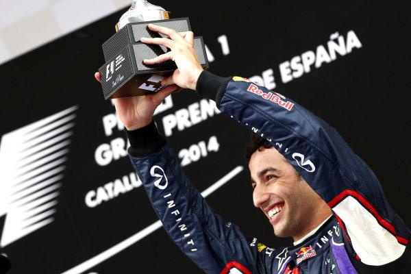 Circuit de Catalunya, Barcelona, Spain. Sunday 11 May 2014. Daniel Ricciardo, Red Bull Racing, 3rd Position, celebrates with his trophy. World Copyright: Andy Hone/LAT Photographic. ref: Digital Image _ONY2143