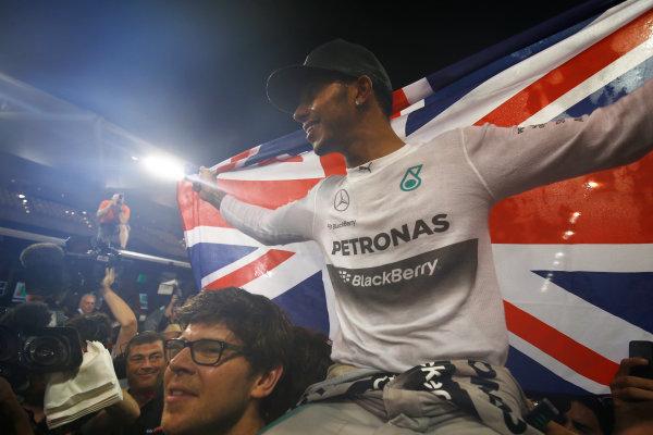 Yas Marina Circuit, Abu Dhabi, United Arab Emirates. Sunday 23 November 2014. Lewis Hamilton, Mercedes AMG, 1st Position, celebrates 2014 title success with his team. World Copyright: Andy Hone/LAT Photographic. ref: Digital Image _ONY2538
