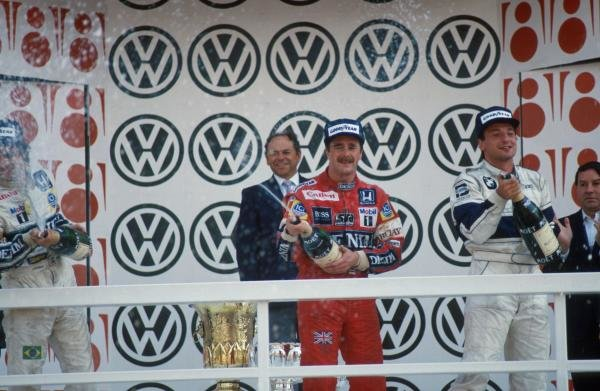 (L to R) 2nd place Nelson Piquet (BRA). Winner Nigel Mansell (GBR). 3rd place Ricardo Patrese (ITA).
