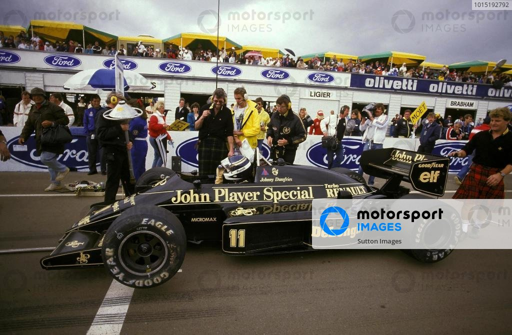 Johnny Dumfries waits on the grid in his TV camera carrying Lotus 98T for his final GP. He went on to take a fine sixth place and provided the world with memorable on-board images.