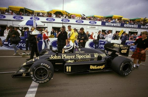 Johnny Dumfries waits on the grid in his TV camera carrying Lotus 98T for his final GP. He went on to take a fine sixth place and provided the world with memorable on-board images. Australian Grand Prix, Adelaide, Australia, 26 October 1986. BEST IMAGE