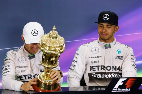 Silverstone Circuit, Northamptonshire, England. Sunday 5 July 2015. Nico Rosberg, Mercedes AMG, 2nd Position, inspects the trophy of Lewis Hamilton, Mercedes AMG, 1st Position, in the Press Conference. World Copyright: Alastair Staley/LAT Photographic ref: Digital Image _R6T7605