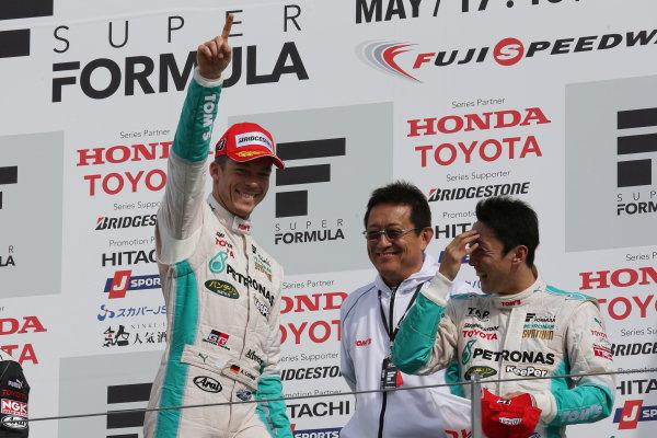 2014 Super Formula Series. Fuji, Japan. 17th - 18th May 2014. Rd 2. Race 2 - Winner Andre Lotterer ( #36 PETRONAS TOM'S SF14 ) podium portrait World Copyright: Yasushi Ishihara / LAT Photographic. Ref: 2014SF_Rd2_022.JPG