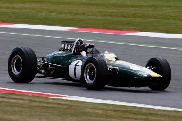 Silverstone, Northamptonshire, England. Friday 4 July 2014. Jackie Oliver drives Jim Clarks Lotus 33 in the historic parade celebrating the 50th running of the British Grand Prix at Silverstone. World Copyright: Charles Coates/LAT Photographic. ref: Digital Image _N7T7487