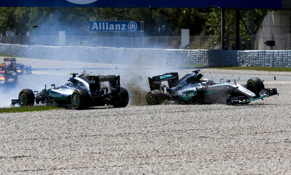 Lewis Hamilton, Mercedes F1 W07 Hybrid, and Nico Rosberg, Mercedes F1 W07 Hybrid, collide into Repsol corner while battling for the lead on the opening lap of the race.