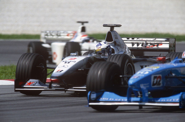 Sepang, Kuala Lumpur, Malaysia. 15-17 October 1999. David Coulthard (McLaren MP4/14 Mercedes) between Alex Wurz (Benetton B199 Playlife)and Johnny Herbert (Stewart SF-3 Ford). Action. Ref: 99MAL55. World Copyright - LAT Photographic