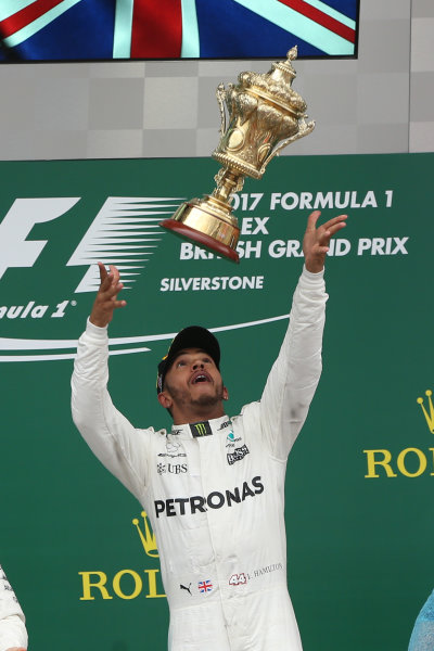 Silverstone, Northamptonshire, UK.  Sunday 16th July 2017. Lewis Hamilton, Mercedes AMG Throws his trophy in the air World Copyright: JEP/LAT Images