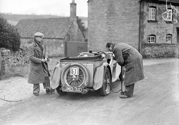 H. Blackall re-inflates the tyre on his MG.