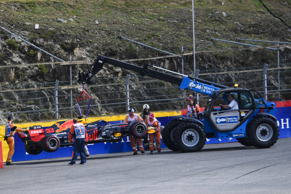 The damaged Max Verstappen Red Bull Racing RB15 is removed by a crane and marshals