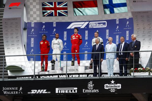 Charles Leclerc, Ferrari, celebrates on the podium with Lewis Hamilton, Mercedes AMG F1 and Valtteri Bottas, Mercedes AMG F1