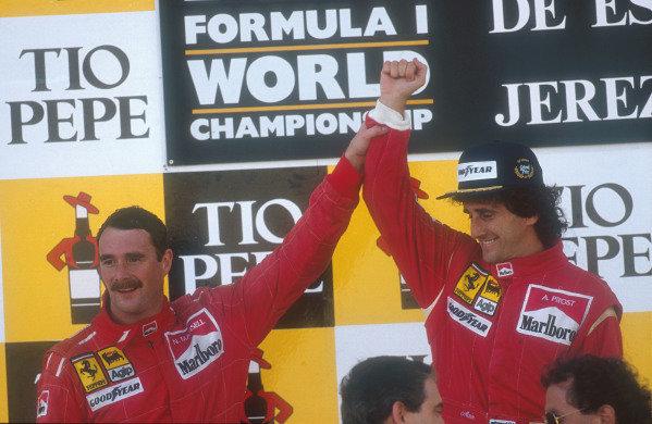 1990 Spanish Grand Prix.Jerez, Spain.28-30 September 1990.Alain Prost, 1st position celebrates on the podium with teammate Nigel Mansell, 2nd position (both Ferrari).Ref-90 ESP 03.World Copyright - LAT Photographic