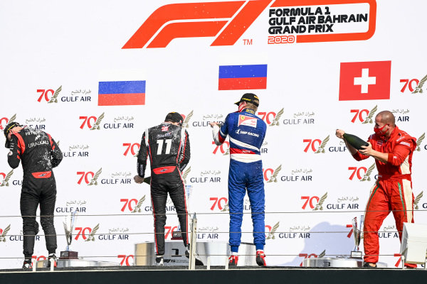 Nikita Mazepin (RUS, HITECH GRAND PRIX), Louis Deletraz (CHE, CHAROUZ RACING SYSTEM), Robert Shwartzman (RUS, PREMA RACING) and Winning Constructor Representative celebrate on the podium with the champagne