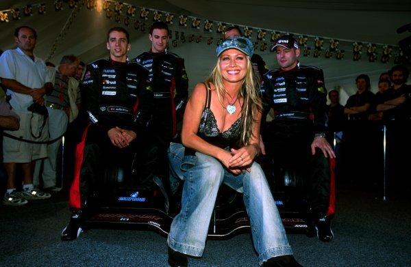 Model Sarah Jane (AUS) helped the Minardi team launch their new PS03. Drivers (L to R): Justin Wilson (GBR) Minardi, test driver Matteo Bobbi (ITA) and Jos Verstappen (NED) Minardi enjoyed the view. Formula One World Championship, Rd 1, Australian Grand Prix, Albert Park, 9 March 2003.BEST IMAGE