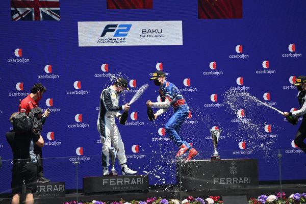 Robert Shwartzman (RUS, Prema Racing), 1st position, Dan Ticktum (GBR, Carlin), 2nd position, and Guanyu Zhou (CHN, Uni-Virtuosi Racing), 3rd position, on the podium