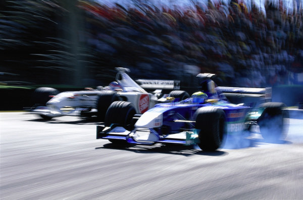 Felipe Massa, Sauber C21 Petronas, locks a wheel as he fights with Jacques Villeneuve, BAR 004 Honda.