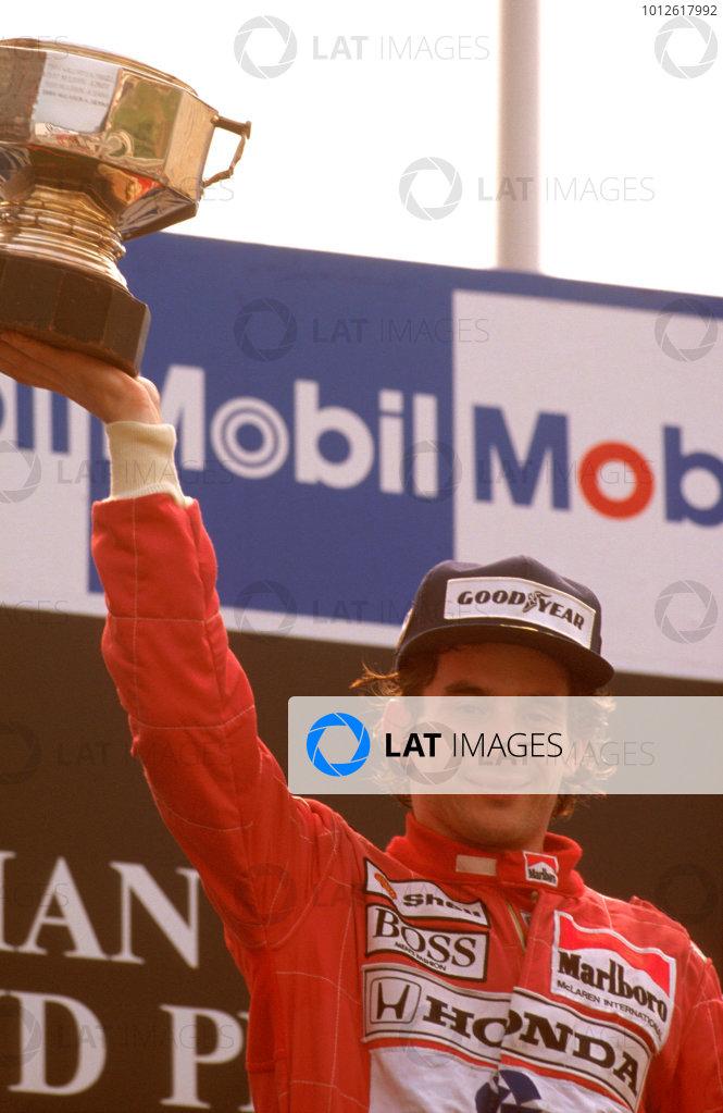 Spa-Francorchamps, Belgium.25-27 August 1989.Ayrton Senna (McLaren MP4/5 Honda) 1st position, on the podium.Ref-89 BEL 03.World Copyright - LAT Photographic
