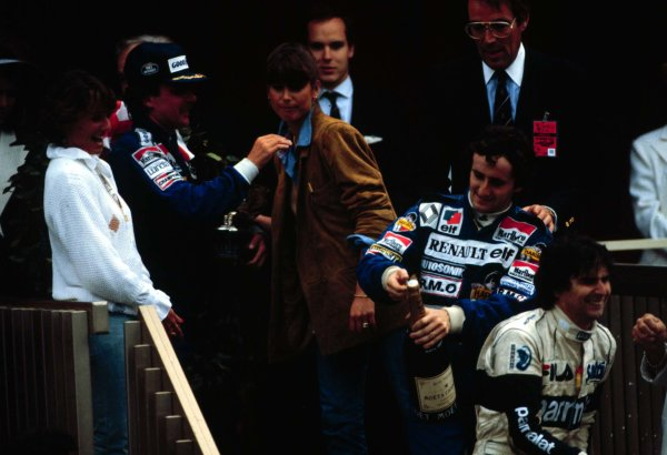 1983 Monaco Grand Prix.Monte Carlo, Monaco.12-15 May 1983.Keke Rosberg (Williams Ford) celebrates 1st position on the podium with his girlfriend Yvonne (far left). Alain Prost (Renault RE40) 3rd position, Nelson Piquet (Brabham BT52 BMW) 2nd position with his girlfriend Sylvia (third left).World Copyright - LAT Photographic