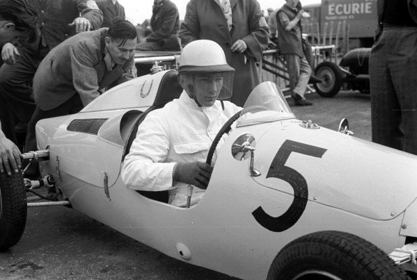 1948 500cc race, British Grand Prix meeting.Silverstone, Great Britain.2 October 1948.Stirling Moss (Cooper) is pushed in the paddock by his father to the grid.World - LAT Photographic