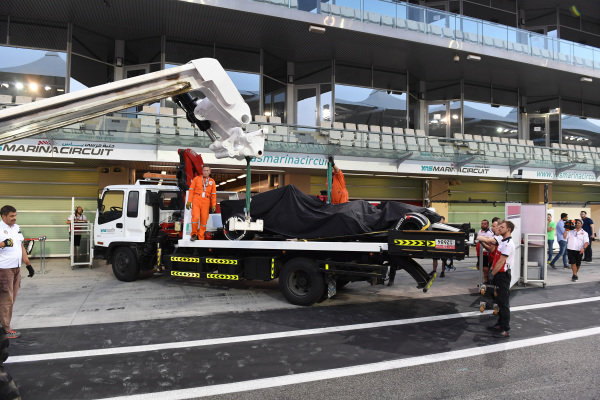 The car of Kimi Raikkonen, Alfa Romeo Sauber C37 is recovered to the pits